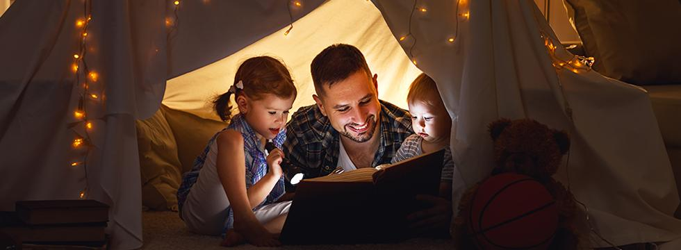 Father Reading to his children in fort